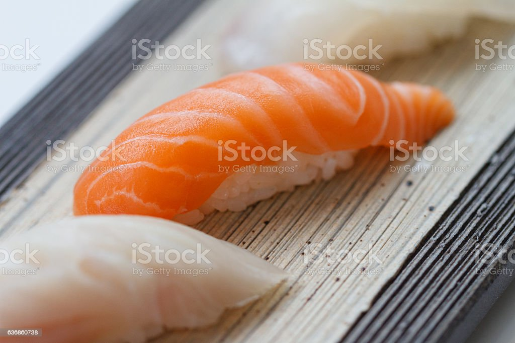 Closed up Raw Salmon Sushi on the Stone Plate. stock photo
