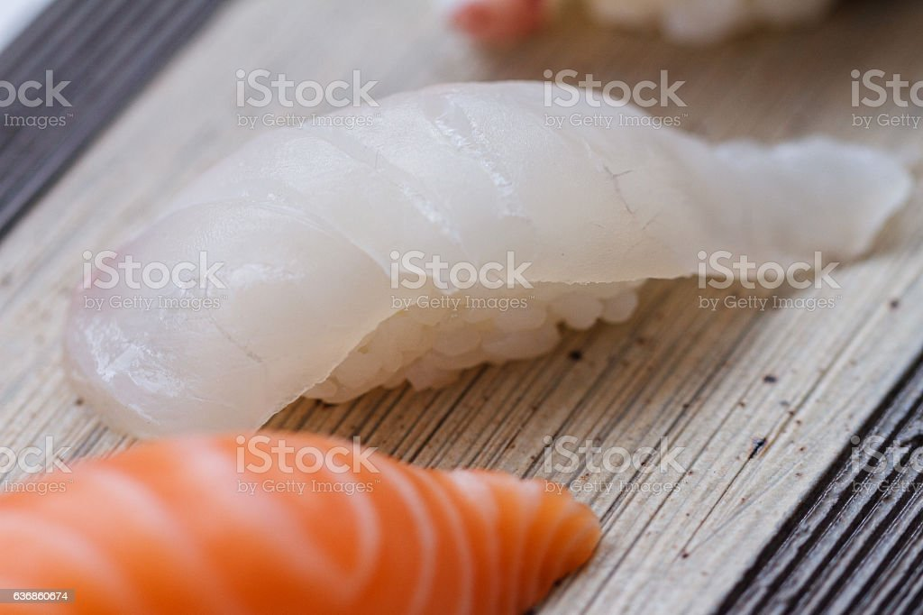 Closed up Squid Sushi on the Stone Plate. stock photo