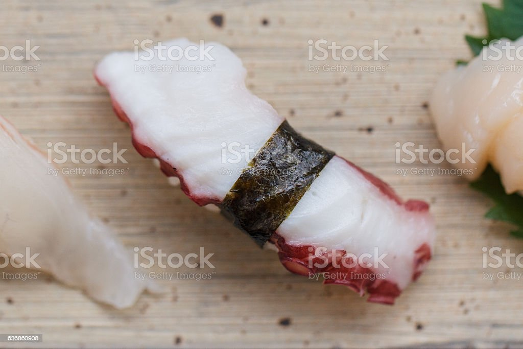 Closed up Squid Tentacle Sushi on the Stone Plate. stock photo