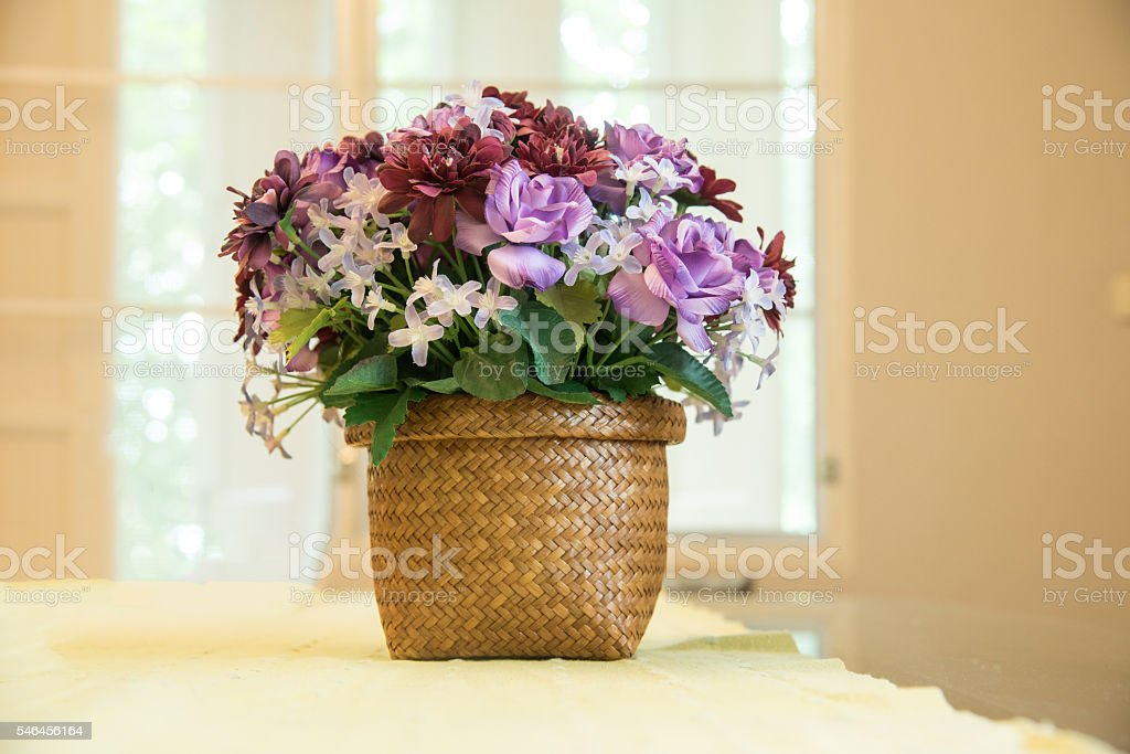closed up the faked purple flower on vase stock photo