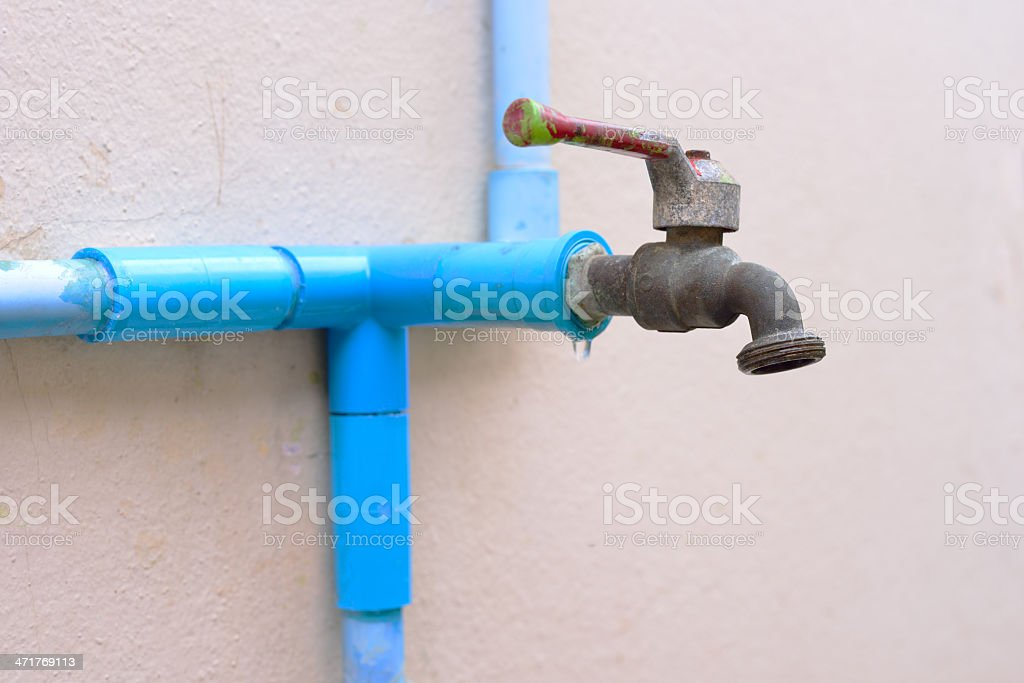 Closed water tap and PVC pipe royalty-free stock photo