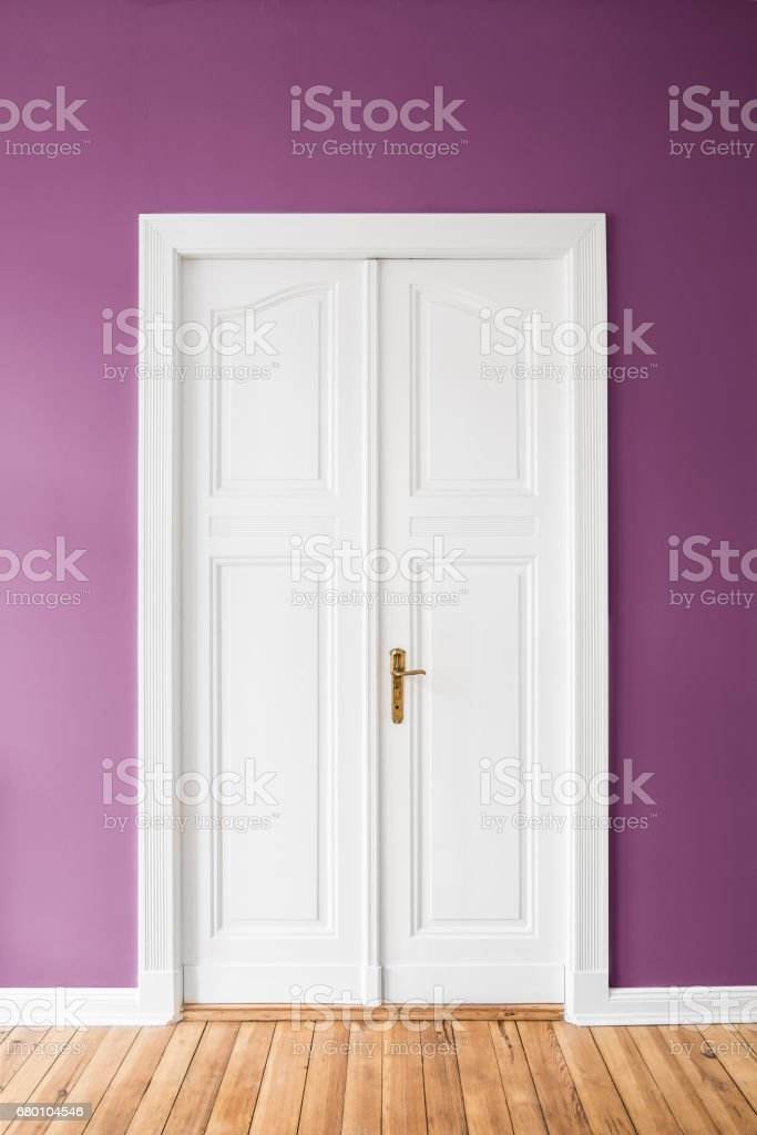 closed wooden door in apartment with colored walls stock photo