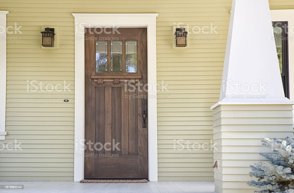 Closed wooden door of a home stock photo