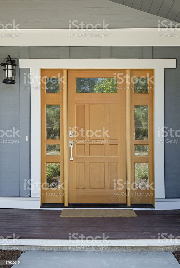 Closed wooden front door of a home stock photo