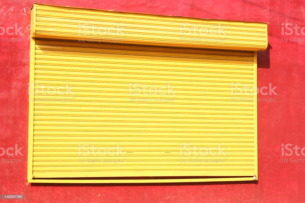 Closed Yellow Shutters royalty-free stock photo