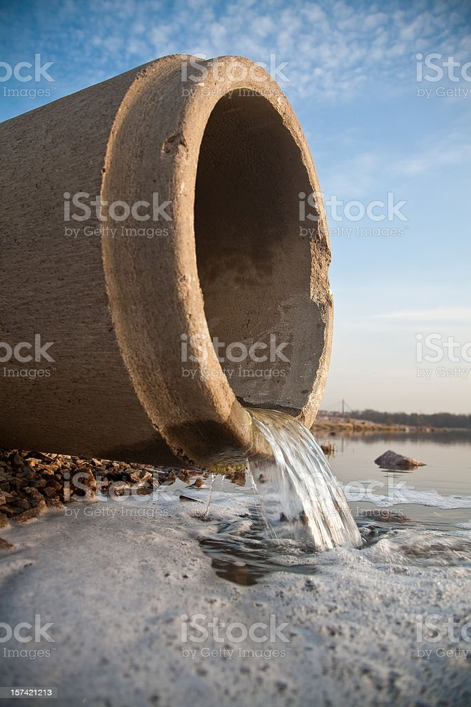 Closer up view of a working sewer pipe stock photo