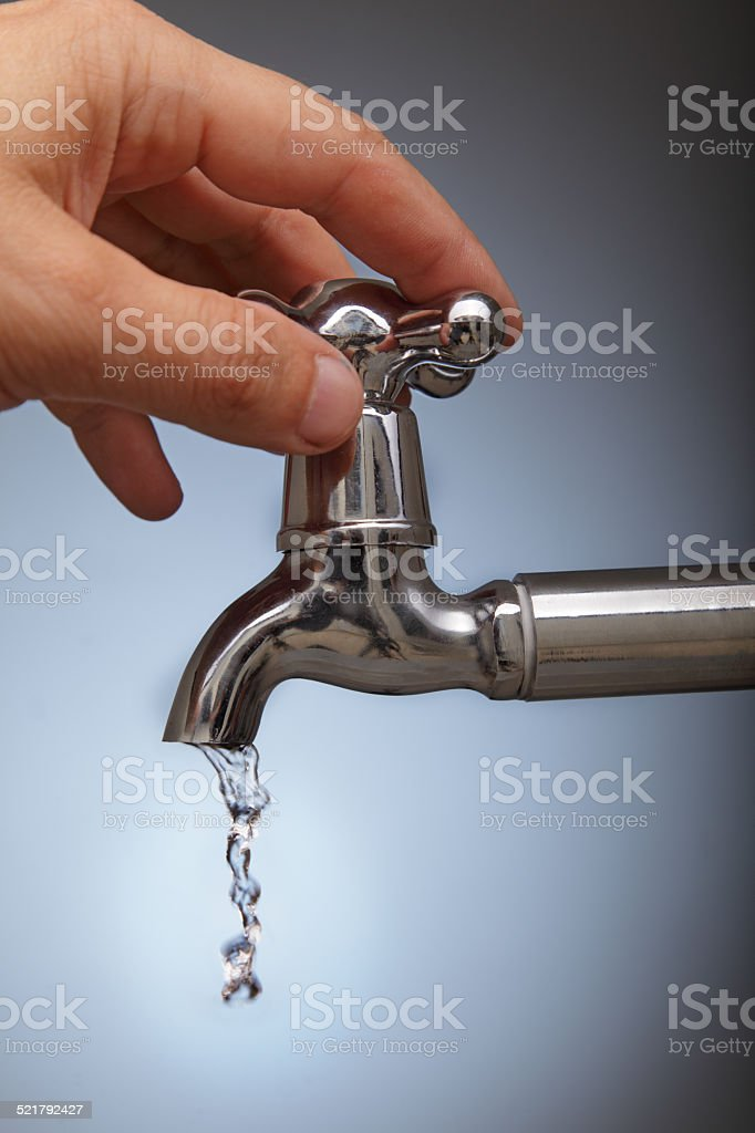 closes the leakage of water stock photo