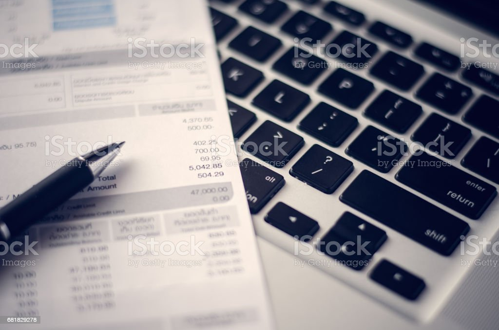 closes up the bill with pen, paper bill charge. stock photo