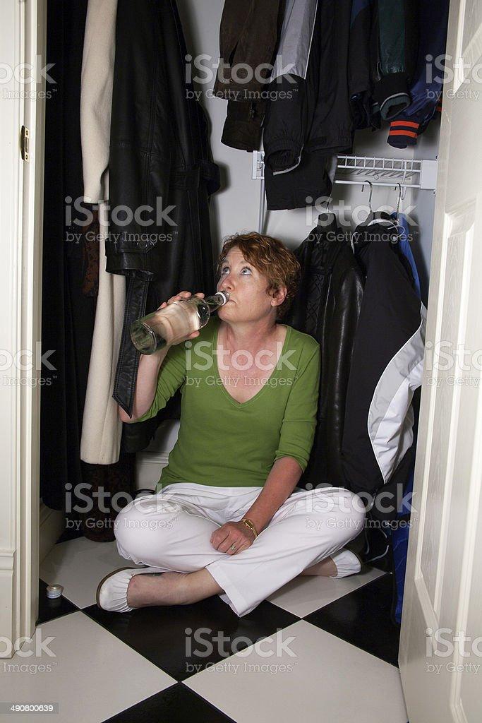 Closet Drinker stock photo