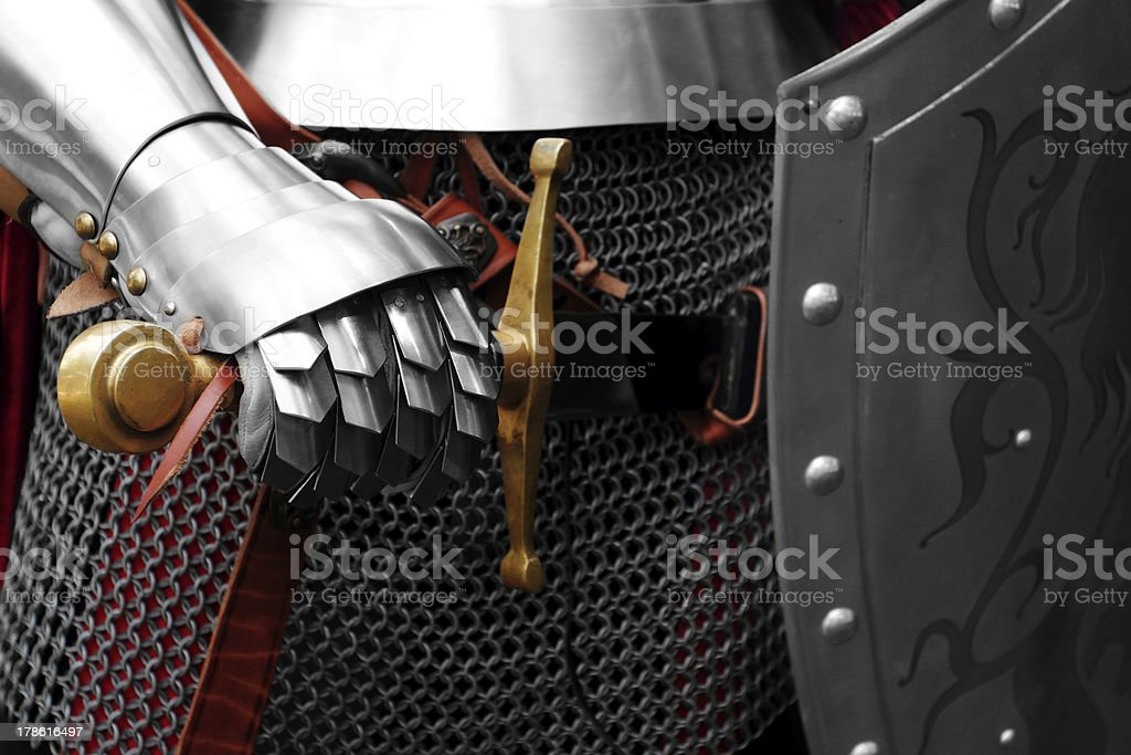 Close-up a Knight pulling his sword out of his sheath stock photo