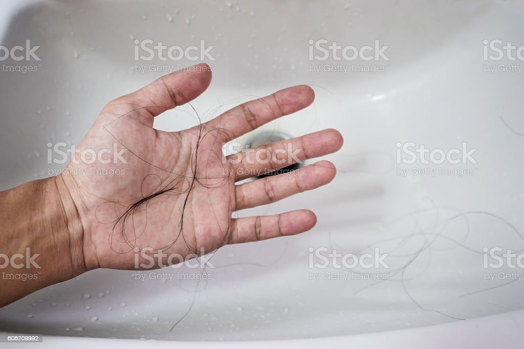 Close-up a man hand with loss hair, after taking shower stock photo