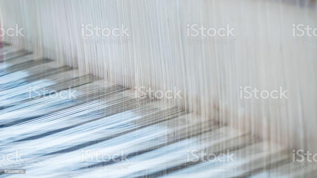 Closeup, abstract motion blur of silk fabric weaving stock photo