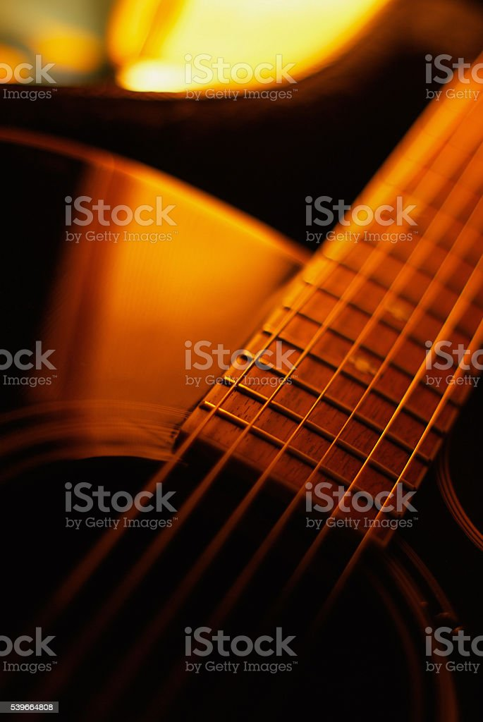 close-up acoustic guitar stock photo