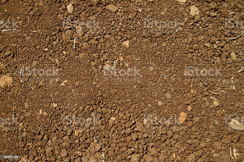 Close-up aerial view of coarse brown soil with no plant life stock photo