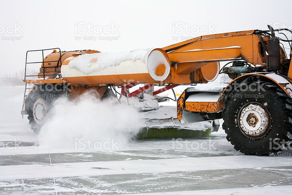 Close-up airfield sweeper on the runway royalty-free stock photo