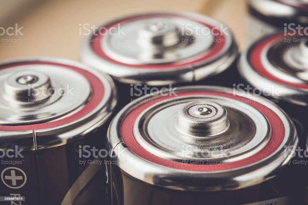 Closeup alkaline batteries in vintage tone stock photo