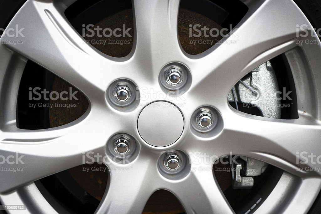 Closeup Alloy wheel rim with bolts stock photo