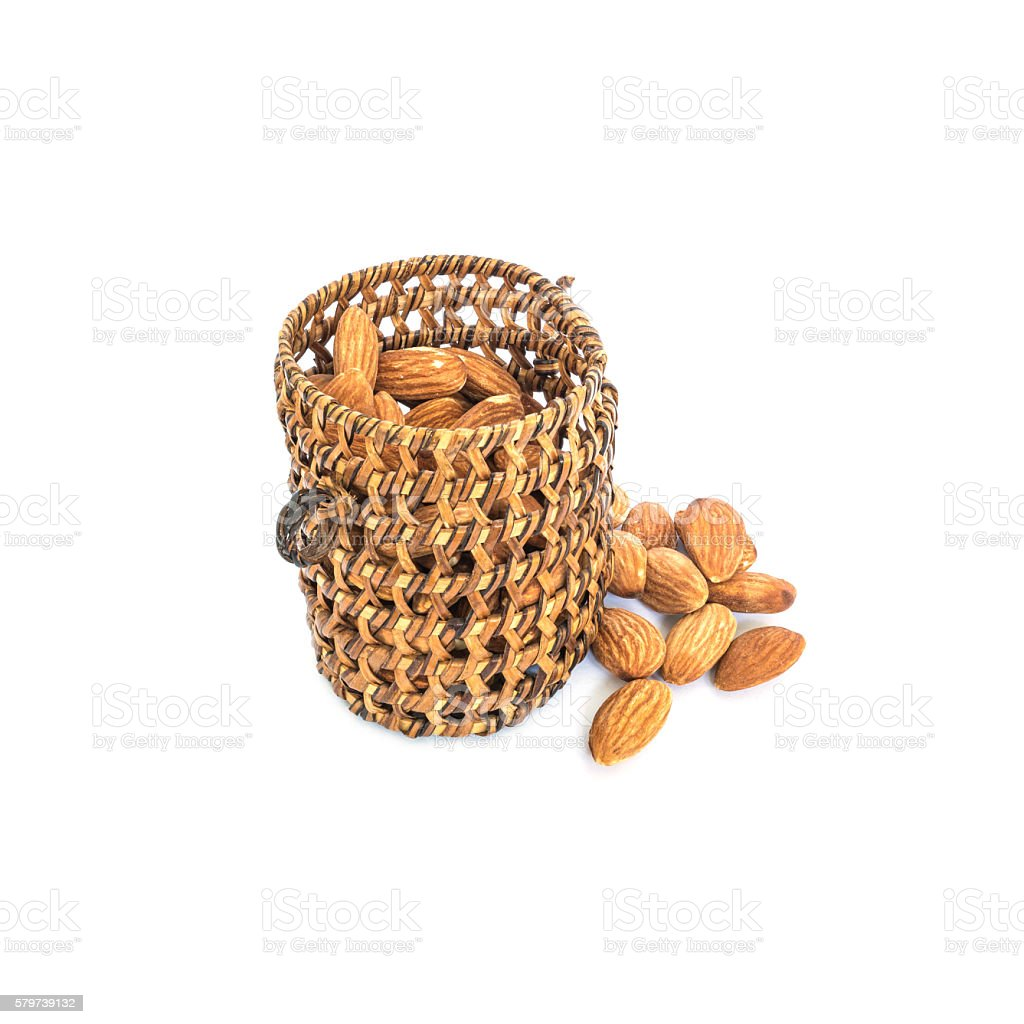 Closeup almond in wooden wickerwork isolated on white background stock photo