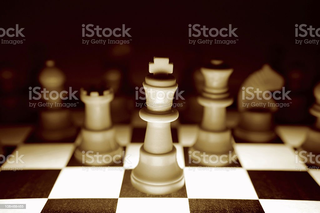 Close-up arrangement of white chess pieces stock photo