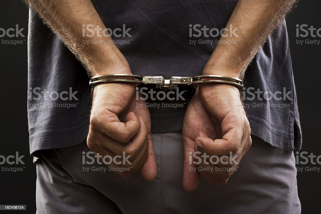 Close-up. Arrested man handcuffed stock photo
