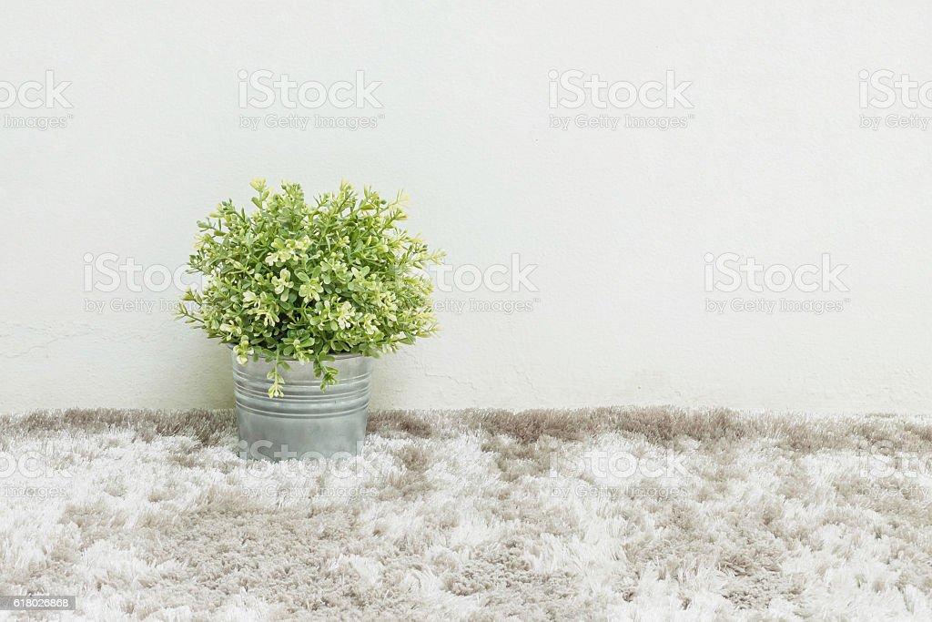 Closeup artificial green plant on gray carpet stock photo