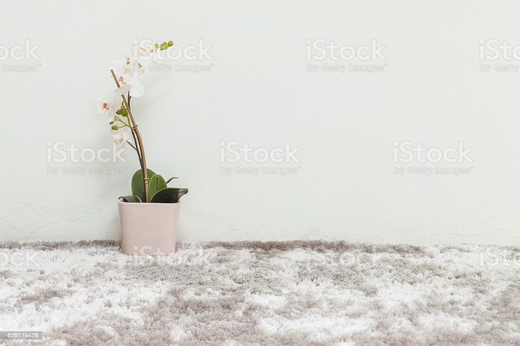 Closeup artificial plant with white orchid in pink pot stock photo