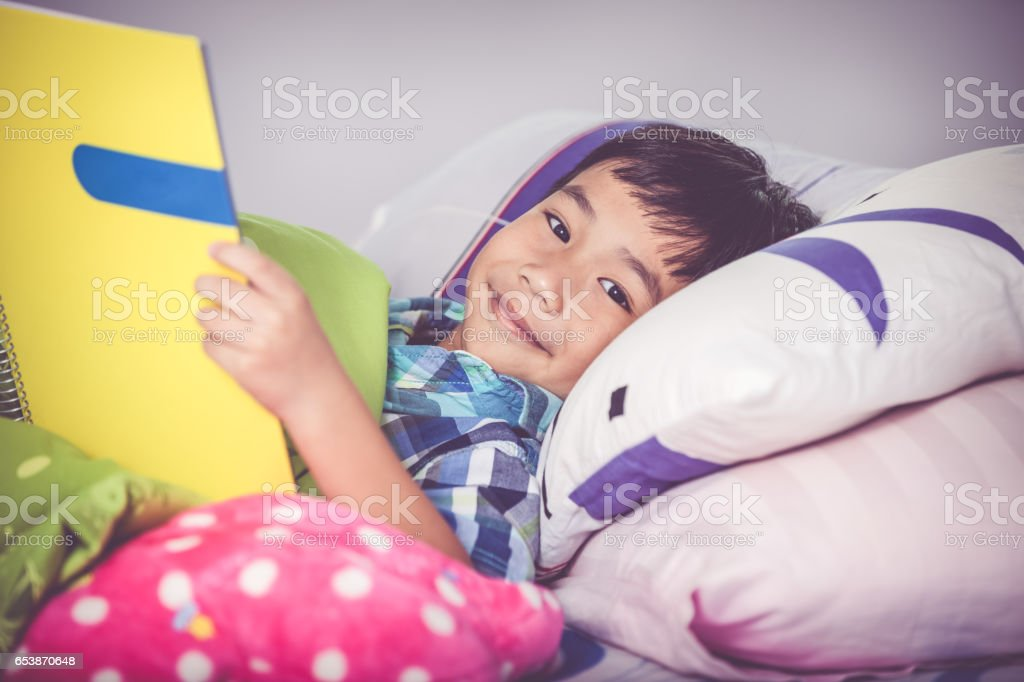 Closeup asian boy reading a book. Education concept. stock photo