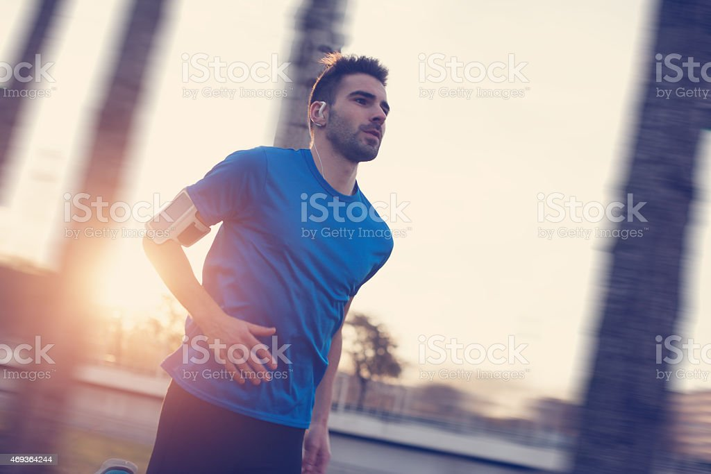 Close-up athlete running in the park stock photo
