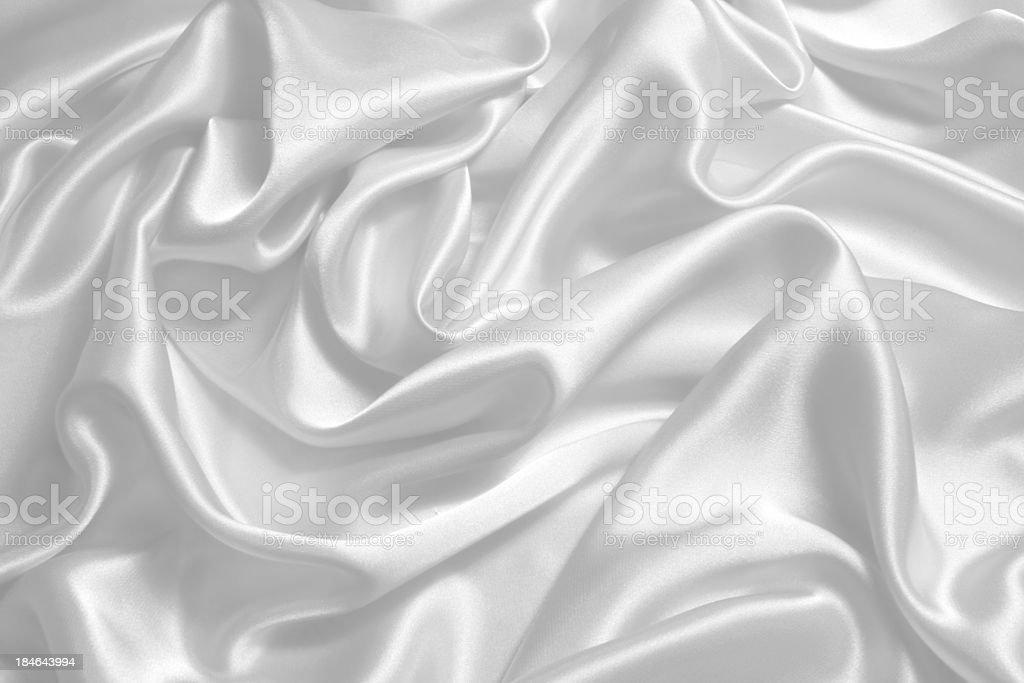 Close-up background image of bright white satin fabric royalty-free stock photo