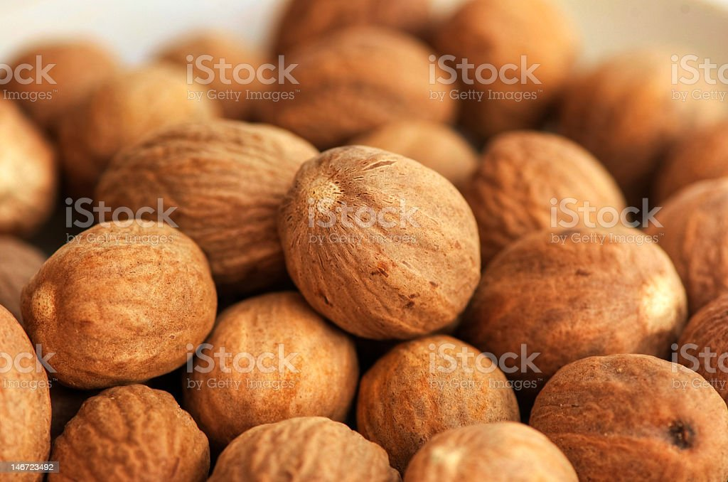Closeup background image of nutmeg stock photo