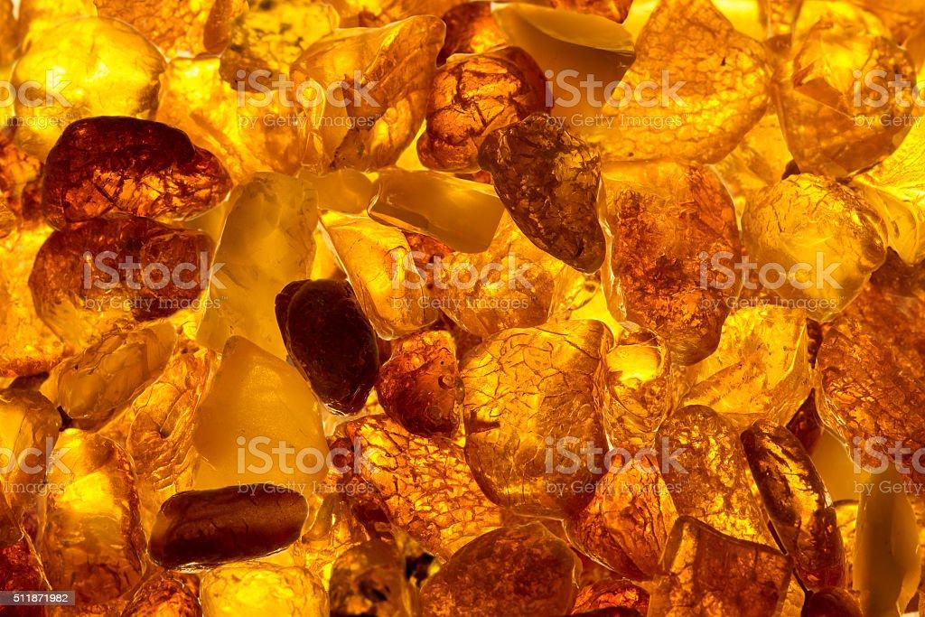 closeup baltic amber stones rectangular lie on a flat surface stock photo