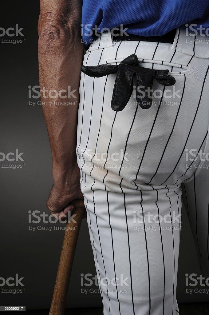 Closeup Baseball Player Leaning on Bat stock photo