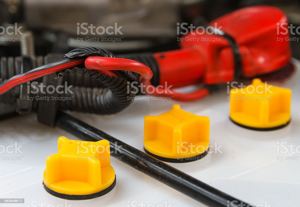 Closeup battery car terminal in engine room. stock photo