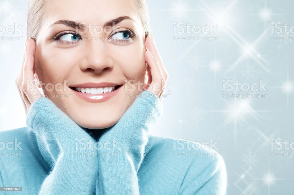 Close-up beautiful face of woman with blue sweater royalty-free stock photo