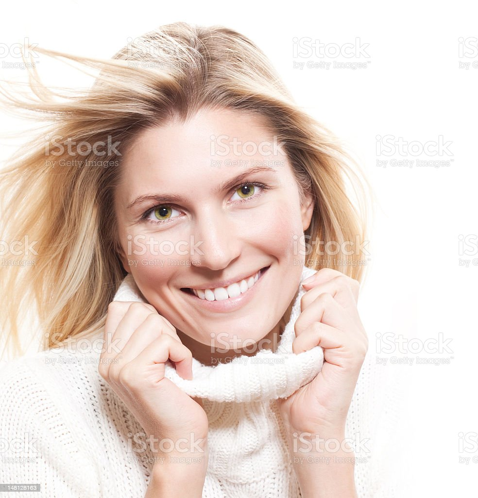 Close-up beautiful face of  woman with white sweater and cap stock photo