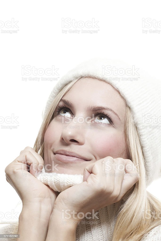 Close-up beautiful face of  woman with white sweater and cap royalty-free stock photo