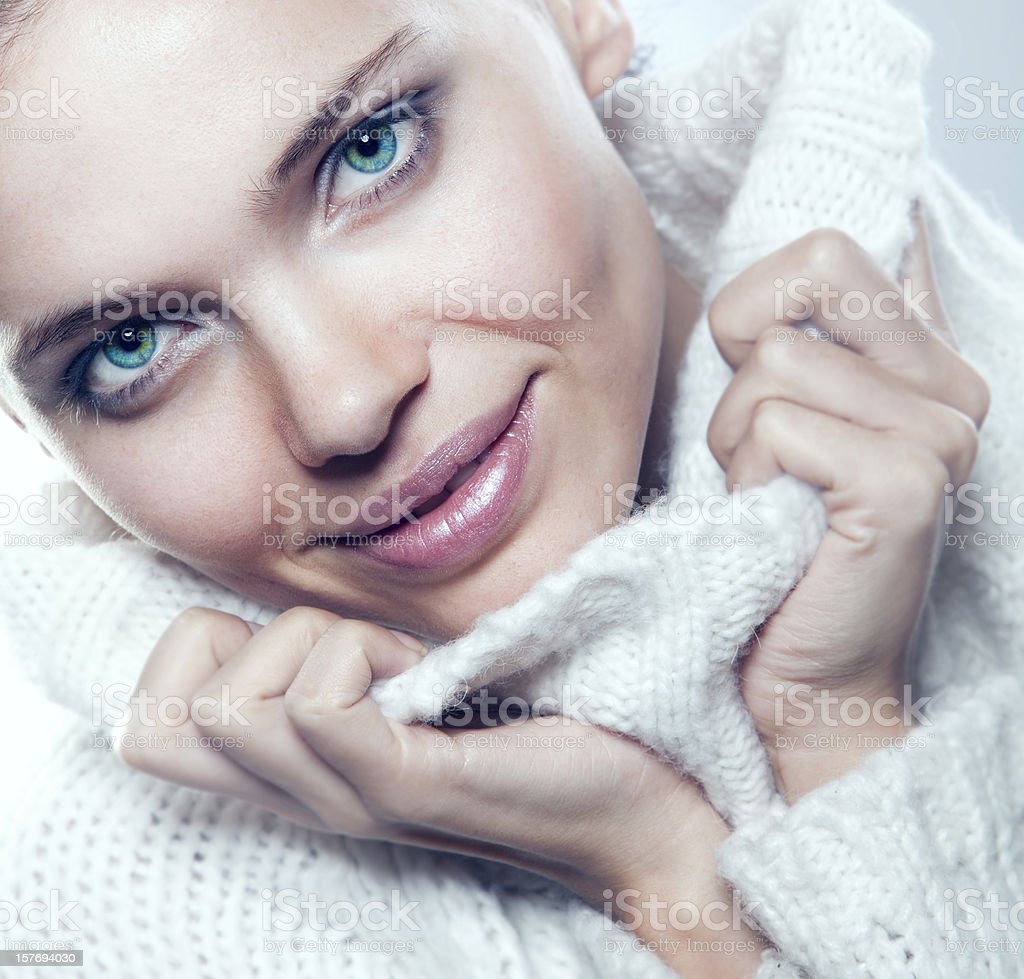 Close-up beautiful face of woman with white sweater royalty-free stock photo