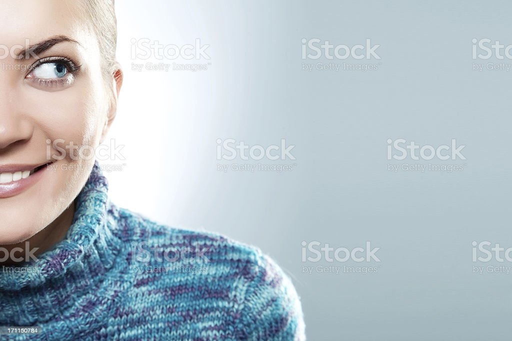 Close-up beautiful face of young woman with blue sweater stock photo