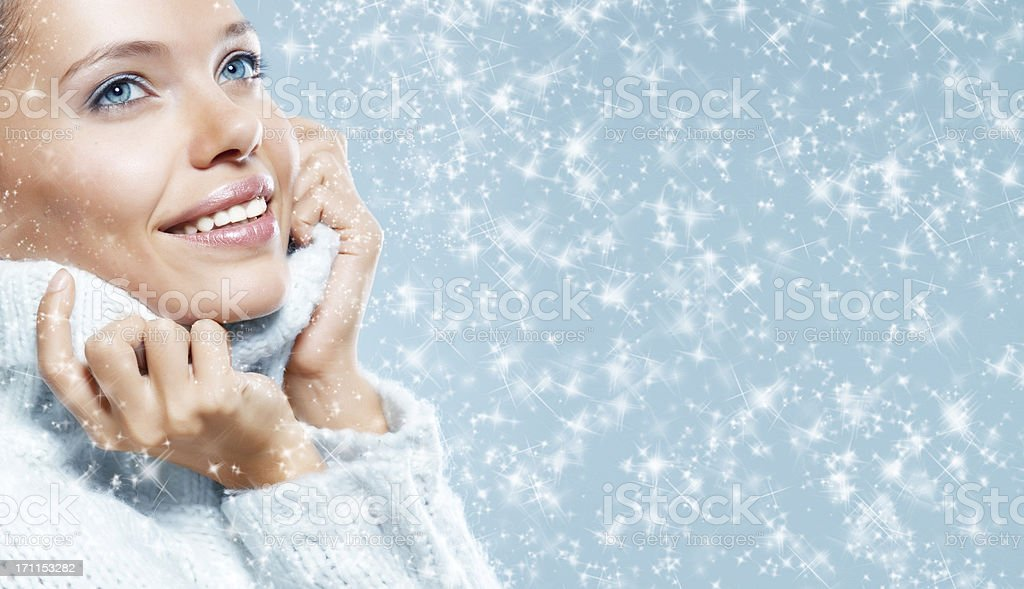 Close-up beautiful face of young woman with white sweater royalty-free stock photo