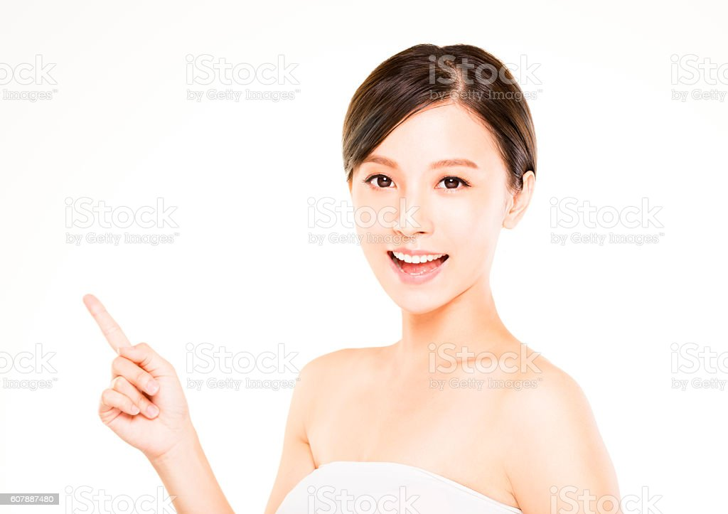 closeup beautiful young   woman  with pointing gesture stock photo