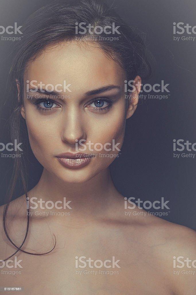 Close-up, beauty portrait of a smiling, beautiful brunette woman stock photo