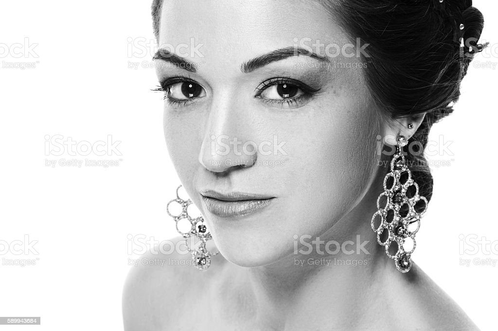 Closeup beauty portrait of young beautiful woman with jewelry. stock photo