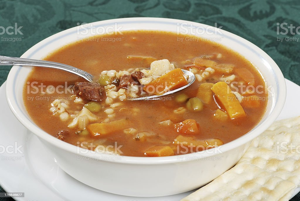 closeup beef barley soup with a spoonful stock photo