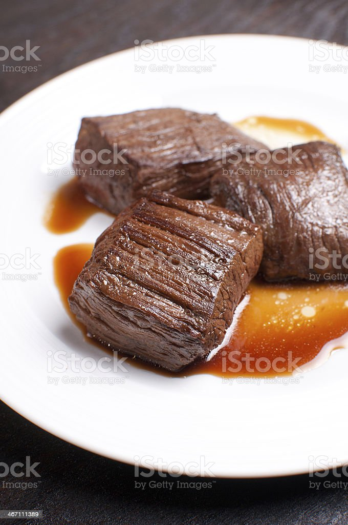Closeup beef cut marinated and cooked stock photo