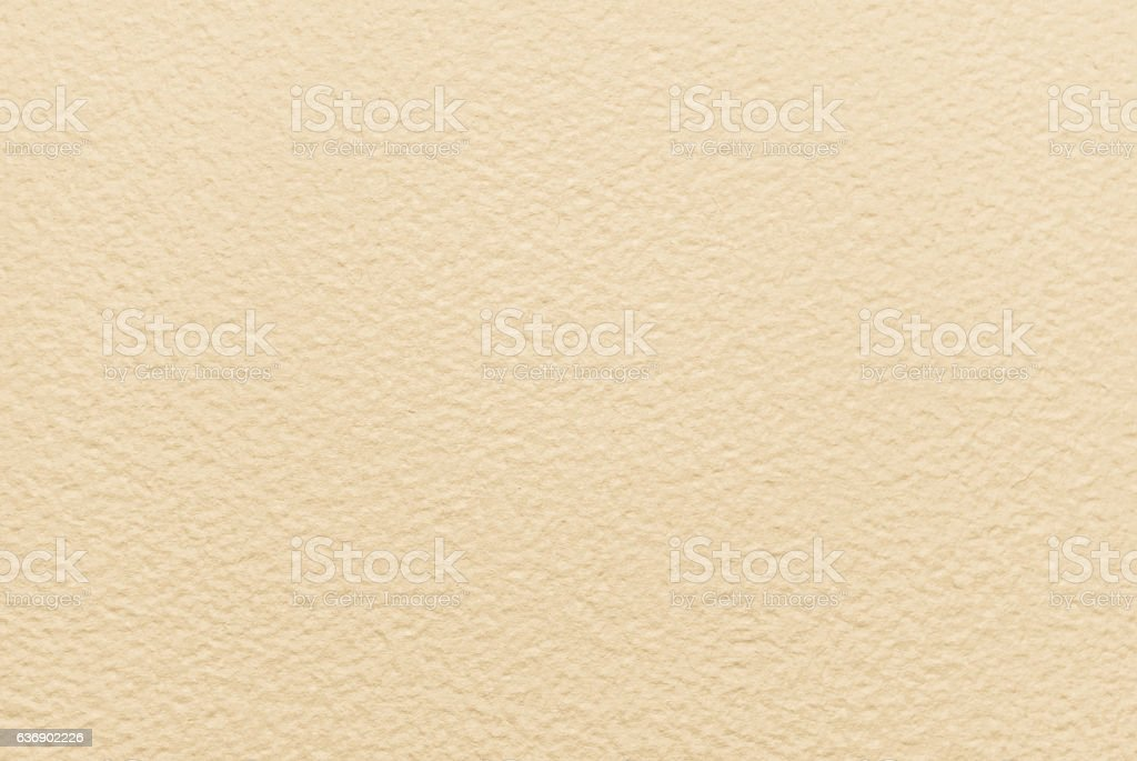 Close-up beige colour handmade hammer effect paper stock photo