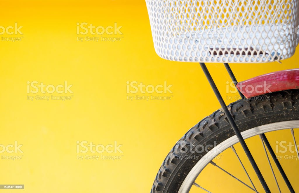 closeup bicycle on yellow wall background for texture stock photo