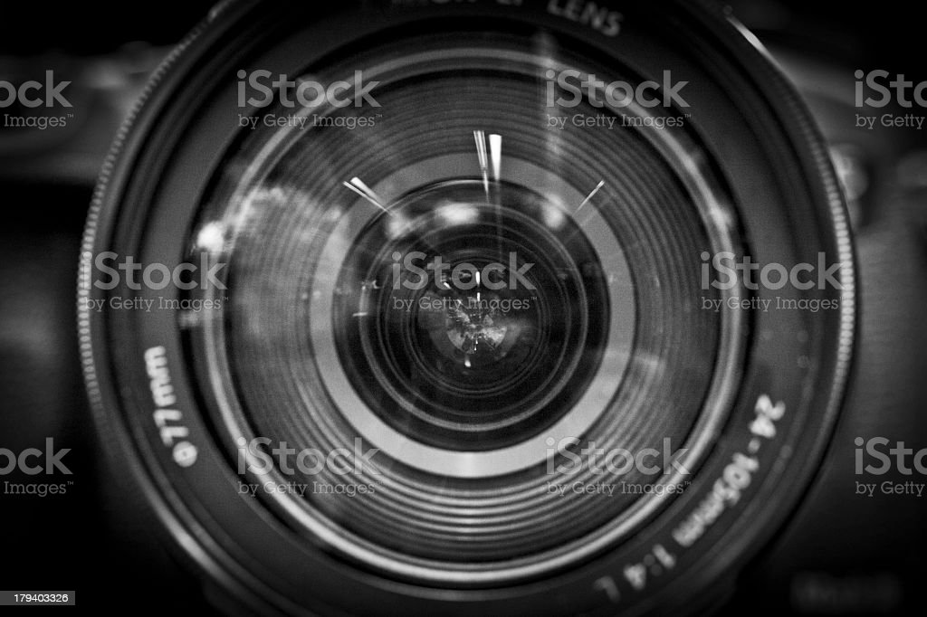 A close-up black and white image of a camera lens stock photo