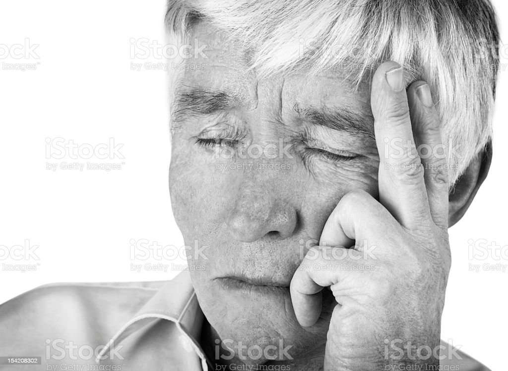 Closeup black and white image of a worried retired man royalty-free stock photo