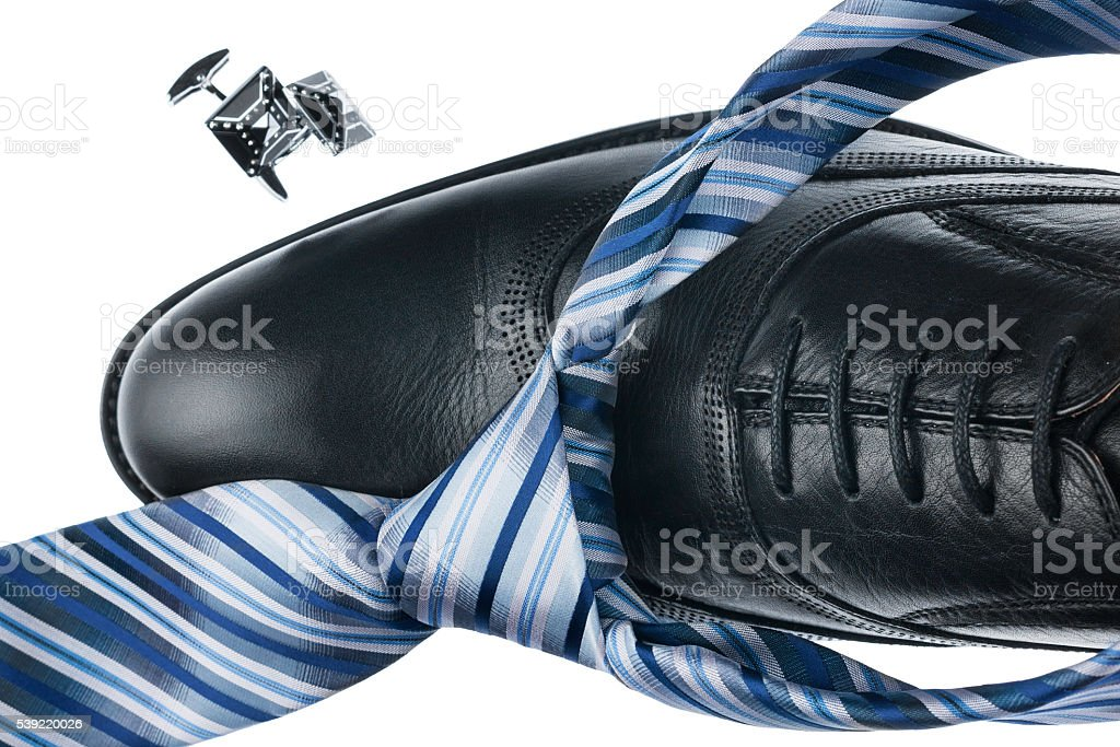 Close-up black shoes and blue tie, isolated stock photo
