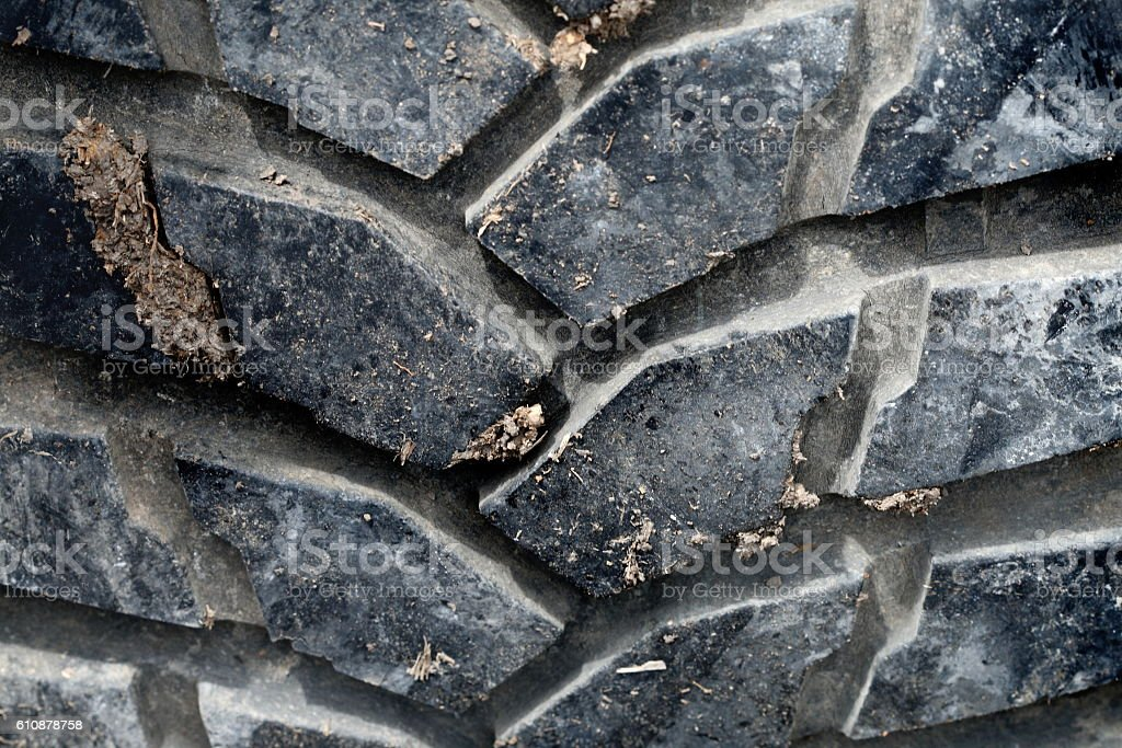 Closeup black tire of off road car have soil dirty stock photo
